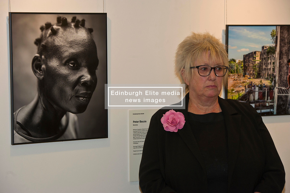 Pictured: Scottish Parliament Deputy Presiding Officer Christine Grahame<br /> Scottish Parliament Deputy Presiding Officer Christine Grahame, Sanne Schim van der Loeff of World Press Photo, and photographer Tom Stoddart were on hand as the World Press Photo exhibition was launched at the Scottish Parliament today.<br /> Ger Harley | EEm 3 August  2017