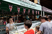 Ice cream seller at Borough Market in London, England, United Kingdom. Borough Market is a retail food market and farmers market in Southwark. It is one of the largest and oldest food markets in London, with a market on the site dating back to at least the 12th century. A farmers market is a physical retail marketplace intended to sell foods directly by farmers to consumers. Farmers markets may be indoors or outdoors and typically consist of booths, tables or stands where farmers sell fruits, vegetables, meats, cheeses, and sometimes prepared foods and beverages.