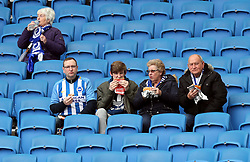 """Brighton and Hove Albion fans in the stands during the Premier League match at the AMEX Stadium, Brighton. PRESS ASSOCIATION Photo. Picture date: Saturday April 7, 2018. See PA story SOCCER Brighton. Photo credit should read: Gareth Fuller/PA Wire. RESTRICTIONS: EDITORIAL USE ONLY No use with unauthorised audio, video, data, fixture lists, club/league logos or """"live"""" services. Online in-match use limited to 75 images, no video emulation. No use in betting, games or single club/league/player publications."""