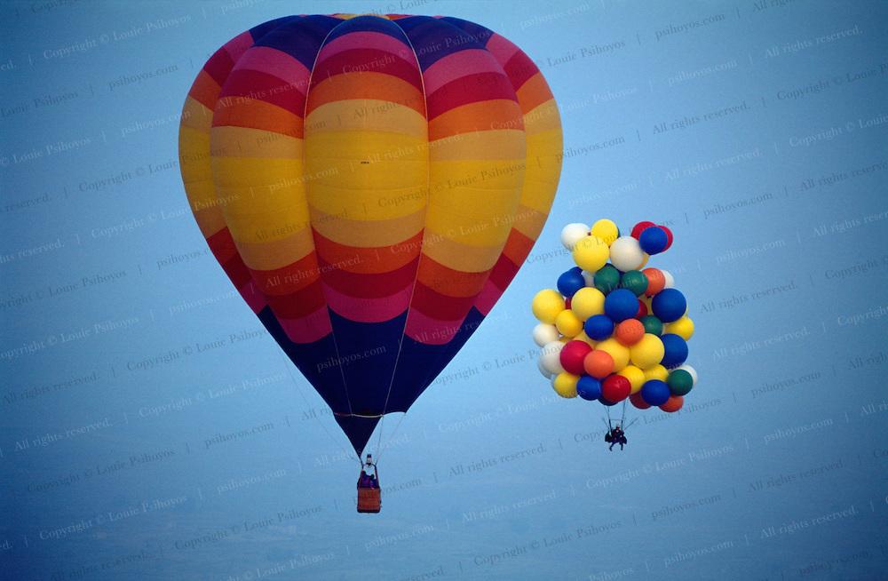 Cluster Ballooner John Ninomiya drifts by a hot air balloon in Coalinga.