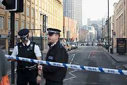 © licensed to London News Pictures. London, UK 01/03/2012. Police officers in Stamford Street as a suspicious package reported at King's College in Stamford Street, London. Photo credit: Tolga Akmen/LNP