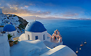 Sunset over the traditional Greek Orthodox churches of Oia (ia), Cyclades Island of  Thira, Santorini, Greece.<br /> <br /> The settlement of Oia had been mentioned in various travel reports before the beginning of Venetian rule, when Marco Sanudo founded the Duchy of Naxos in 1207 and feudal rule was instituted on Santorini. n 1537, Hayreddin Barbarossa conquered the Aegean islands and placed them under Sultan Selim II. However, Santorini remained under the Crispo family until 1566, passing then to Joseph Nasi and after his death in 1579 to the Ottoman Empire. .<br /> <br /> If you prefer to buy from our ALAMY PHOTO LIBRARY  Collection visit : https://www.alamy.com/portfolio/paul-williams-funkystock/santorini-greece.html<br /> <br /> Visit our PHOTO COLLECTIONS OF GREECE for more photos to download or buy as wall art prints https://funkystock.photoshelter.com/gallery-collection/Pictures-Images-of-Greece-Photos-of-Greek-Historic-Landmark-Sites/C0000w6e8OkknEb8