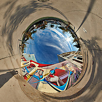 Mirror Ball Building Mural. Tunnel View. Composite of 38 images taken with a Nikon D850 camera and 8-15 mm fisheye lens (ISO 64, 15 mm, f/16, 1/100 sec). Raw images processed with Capture One Pro and Auto Pano Giga.