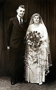 studio portrait of bride and groom England 1930s