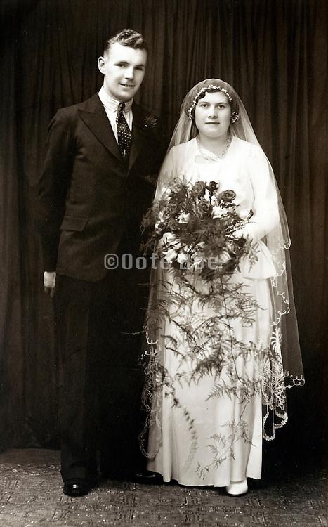 studio portrait of bride and groom England 1930s