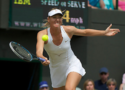 24.06.2011, Wimbledon, London, GBR, Wimbledon Tennis Championships, im Bild Maria Sharapova (RUS) in action during the Ladies' Singles 2nd Round match on day five of the Wimbledon Lawn Tennis Championships at the All England Lawn Tennis and Croquet Club, EXPA Pictures © 2011, PhotoCredit: EXPA/ Propaganda/ *** ATTENTION *** UK OUT!