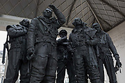 The sculpture forming the Bomber Command War Memorial on 16th March 2017, in Green Park, London, England. The 9-foot 2.7 m bronze sculpture of seven aircrew, designed by the sculptor Philip Jackson look as though they have just returned from a bombing mission and left their aircraft. The figures represent L-R: Navigator, Flight Engineer, Mid-upper gunner, Pilot, Bomb aimer, Rear gunner and Wireless operator. The Royal Air Force Bomber Command Memorial is a memorial in Green Park, London, commemorating the crews of RAF Bomber Command who embarked on missions during the Second World War. The memorial was built to mark the sacrifice of 55,573 aircrew from Britain, Canada, Czechoslovakia, Poland and other countries of the Commonwealth, as well as civilians of all nations killed during raids. Queen Elizabeth II unveiled the memorial on 28 June 2012, the year of her Diamond Jubilee.