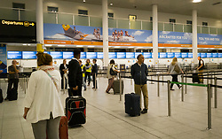 © Licensed to London News Pictures. 23/09/2019. Gatwick, UK. Passengers look for flights as all Thomas Cook check in desks at Gatwick Airport are closed after the travel firm collapsed overnight. The 178 year old travel operator has gone in to liquidation after rescue talks failed overnight. This will trigger the largest peacetime repatriation as more than 150,000 British holidaymakers will need to be brought home. Photo credit: Peter Macdiarmid/LNP