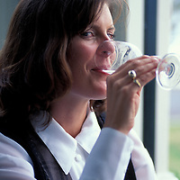 New Zealand, North Island, (MR) Young woman drinks wine at the Esplanade Hotel's pub in Devonport, near Auckland