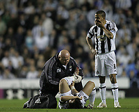 Photo: Lee Earle.<br /> Reading v Newcastle United. The Barclays Premiership. 30/04/2007.Newcastle's Kieron Dyer (R) watches as Emre gets treated for an injury.