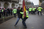 Students tussle with police during protest against government education cuts in Parliament Square. Holding a variety of placards that denounce the coalition government's policy of charging extra higher-education tuition fees, the atmosphere is excited and happy. But tens of thousands of students and school pupils walked out of class, marched, and occupied buildings around the country in the second day of mass action within a fortnight to protest at education cuts and higher tuition fees. There were isolated incidents of violence and skirmishes with police, mostly in central London among the 130,000 students.