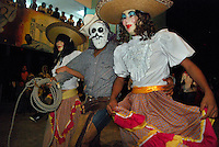 """MEXICO, Veracruz, Tantoyuca, Oct 27- Nov 4, 2009. Costumed """"xantolo"""" dancers perform at the Preparatorio Benito Juarez in Tantoyuca. """"Xantolo,"""" the Nahuatl word for """"Santos,"""" or holy, marks a week-long period during which the whole Huasteca region of northern Veracruz state prepares for """"Dia de los Muertos,"""" the Day of the Dead. For children on the nights of October 31st and adults on November 1st, there is costumed dancing in the streets, and a carnival atmosphere, while Mexican families also honor the yearly return of the souls of their relatives at home and in the graveyards, with flower-bedecked altars and the foods their loved ones preferred in life. Photographs for HOY by Jay Dunn."""