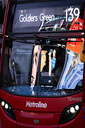 Seen reflected in the windscreen of a passing bus are images and video clips from retail ads at Piccadilly Circus in the capital's West End, on 5th February 2021, in London, England.