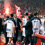 Anadolu Efes's coach Oktay Mahmuti (C) during their Turkish Airlines Euroleague Basketball playoffs Game 5 Olympiacos between Anadolu Efes at SEF Indoor Hall in Piraeus, in Greece, Friday, April 26, 2013. Photo by TURKPIX