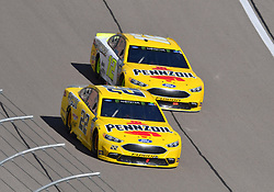 March 4, 2018 - Las Vegas, NV, U.S. - LAS VEGAS, NV - MARCH 04: Joey Logano (22) Team Penske Pennzoil Ford Fusion and Ryan Blaney (12) Team Penske Ford Fusion drive side-by-side during the Monster Energy NASCAR Cup Series Pennzoil 400 on March 04, 2018 at Las Vegas Motor Speedway in Las Vegas, NV. (Photo by Chris Williams/Icon Sportswire) (Credit Image: © Chris Williams/Icon SMI via ZUMA Press)