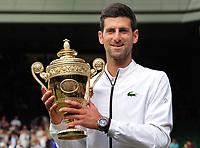 Tennis - 2019 Wimbledon Championships - Week Two, Sunday (Day Thirteen)<br /> <br /> Men's Singles, Final: Novak Djokovic (SRB) vs. Roger Federer (SUI)<br /> <br /> Novak Djokovic with the trophy, on Centre Court.<br /> <br /> COLORSPORT/ANDREW COWIE