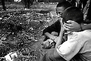 A Huelepega comforts another child after a fight broke out in the group in Mangaua, Nicaragua on February 12, 2007. Although fights are common the children have no choice but to stick together for protection..Nicaragua has known chronic war and poverty, forces that over time can break the fabric that holds families together. In a Society where poor single mothers are common and must provide for large families in Latin America's most devastated economy, it is inevitable that children are forced to choose between abuse and hunger in the home, or the street. A growing number have been choosing the street. Most get addicted to glue. Called Huelepegas, or glue sniffers they are ostracized far beyond the lowest rung of society. Although NGOs have cobbled together a few basic services to support the children, it is up to President Ortega's new socialist government to address this growing problem after years of neglect.