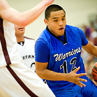 030113  Adron Gardner/Independent<br /> <br /> Navajo Pine Warrior Kevin Bia (12) drives past the Ramah Mustangs during the 1-2A district final in Ramah March, 2.