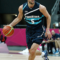31 July 2012: Argentina Manu Ginobilo brings the ball upcourt during 71-64 Team France victory over Team Argentina, during the men's basketball preliminary, at the Basketball Arena, in London, Great Britain.