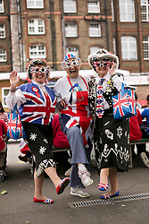 © Licensed to London News Pictures. 31/05/2012. .Newham East London, UK..East London Gets the Party Started..Zaneta Prince from the Variety Club ( centre) is joined by Pearly Queens Doreen Golding and Christine Prosser at New City Primary School as the school start the celebrations for the  Diamond Jubilee Weekend,  with street party style lunch for the pupils in the school playground. .Photo credit : Andrew Baker/LNP