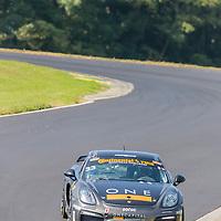 Alton, VA - Aug 26, 2016:  The CJ Wilson One Capital Management MotorOilMatters.org Porsche Cayman GT4 races through the turns at the Oak Tree Grand Prix at Virginia International Raceway in Alton, VA.