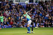 Joe Pigott of AFC Wimbledon holds back Frazer Blake-Tracy of Peterborough United as the ball comes in during the EFL Sky Bet League 1 match between Peterborough United and AFC Wimbledon at London Road, Peterborough, England on 28 September 2019.