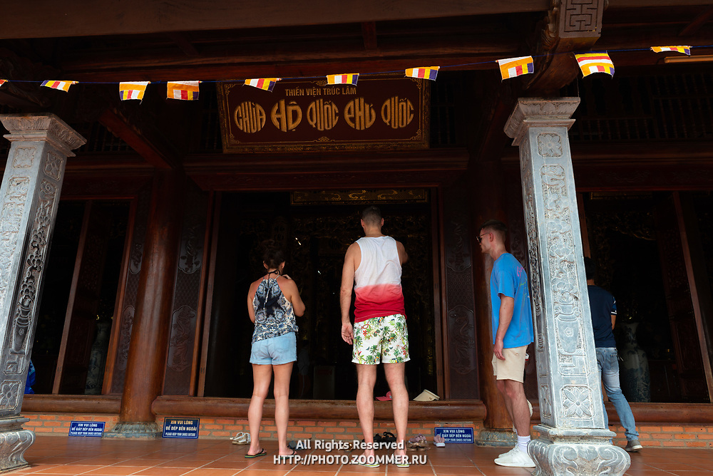 Tourists near the doors of Buddha Chamber in Ho Quoc Monastery,  Phu Quoc