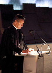 © licensed to London News Pictures. ANZAC MEMORIAL, LONDON, UK  25/04/11. A chaplain delivers a sermon in front of the Australian War Memorial in Hyde Park Corner. Thousands gathered at a dawn service at the Australian and New Zealand War Memorials in London today to remember the fallen soldiers of those countries as part of Anzac Day. Please see special instructions for usage rates. Photo credit should read Matt Cetti-Roberts/LNP