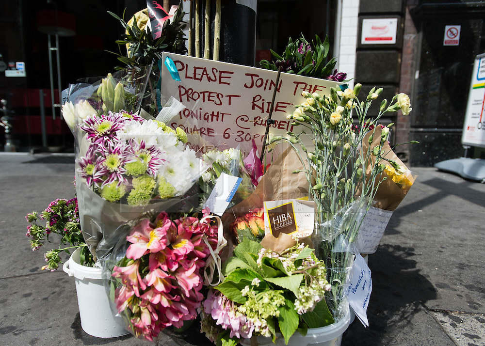 © Licensed to London News Pictures. 16/07/2013. London, UK. A memorial to the cyclist killed yesterday by a tipper truck at the scene of the incident in central London Photo credit : Richard Isaac/LNP