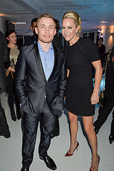 Boxer CARL FRAMPTON and EMMA SPENCER at the London premier of Being AP held at Altitude 360, Millbank Tower, 30 Millbank, London on 23rd November 2015.