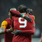 Galatasaray's Johan Elmander celebrate his goal with team mate during their Turkish superleague soccer derby match Galatasaray between Fenerbahce at the TT Arena in Istanbul Turkey on Friday, 18 March 2011. Photo by TURKPIX