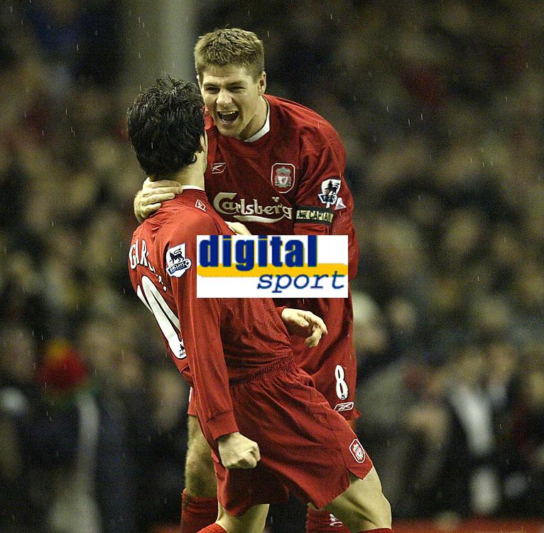 Photo: Aidan Ellis.<br /> Liverpool v Arsenal. The Barclays Premiership. 14/02/2006.<br /> Liverpool's Steven Gerrard congratulates goal scorer Luis Garcia