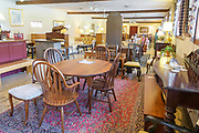 At McLiman's Furniture Warehouse in Kennett Square, Pa 28 April 2018. Photograph by Jim Graham