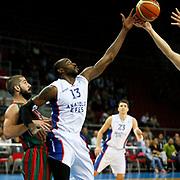 Anadolu Efes's Stephane Lasme (2ndR) during their Turkish Basketball League match Anadolu Efes between Pinar Karsiyaka at Abdi Ipekci Arena in Istanbul Turkey on Sunday 02 November 2014. Photo by Aykut AKICI/TURKPIX