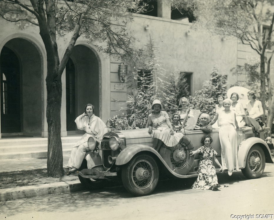 1931 Ladies with vintage car in front of the Hollywood Studio Club at 1215 Lodi Pl
