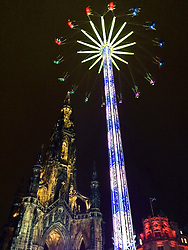 Pictured: <br /> <br /> While the torchlight procession was passing along Princes Street, the Scott Monument maintainind its graduer as it has seen it all before and will still be there nwext year.<br /> <br /> Chris McCluskie 30 December 2016