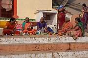 A group of Indian women sit and talk on the banks of the river ganges at dawn on 21st December 2009, Varanasi / Benares, Uttar Pradesh, India. According to Hindu mythology, Varanasi was founded by Shiva, one of three principal deities along with Brahma and Vishnu, and is seen as a significant and holy place to followers of the Hundu faith.