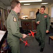 New first year pilots of the Red Arrows, Britain's RAF aerobatic team discuss new manoeuvres at RAF Scampton.