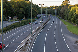 Licensed to London News Pictures. 27/09/2021. Dorking, UK. A very quiet rush hour on the A3 Kingston Bypass south-west London this evening (18:07), a major road in and out of the Capital and usually synonymous with long tailbacks as motorists continue to struggle to find petrol stations with fuel. Large queues have formed at petrol stations across the country over the weekend with many running out of fuel as oil giants struggle to maintain deliveries due to the lack of HGV drivers. Photo credit: Alex Lentati/LNP