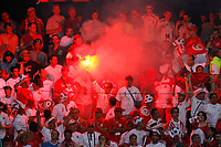 Photo: Glyn Thomas.<br />Tunisia v Saudi Arabia. Group H, FIFA World Cup 2006. 14/06/2006.<br /> A Tunisia fan sets off a flare after his team's takes a 1-0 lead.