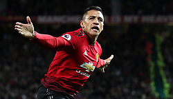 Manchester United's Alexis Sanchez celebrates scoring his side's third goal of the game during the Premier League match at Old Trafford, Manchester.