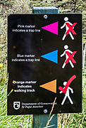 Trap line marker symbol explanation sign. The Milford Track in Fiordland National Park, Southland region, South Island of New Zealand. Nonnative predators such as stoats & rats have devastated New Zealand's unique bird life. Recent rodent trapping & poisoning efforts have helped keep some bird species from decimation. Norway rats were on the ships of the first explorers, who arrived in New Zealand in the late 1700s. Stoats, weasels, and ferrets were introduced to New Zealand as early as 1879 to control nonnative rabbits that were destroying sheep pasture. Almost without exception, introduced species have been detrimental to the native flora and fauna. However, trekking into remote NZ parks still makes a wonderful escape into what's left of the uniquely beautiful Gondwanan wilderness. In 1990, UNESCO honored Te Wahipounamu - South West New Zealand as a World Heritage Area.