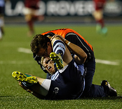 Gareth Anscombe of Cardiff Blues receives medical attention<br /> <br /> Photographer Simon King/Replay Images<br /> <br /> Guinness PRO14 Round 4 - Cardiff Blues v Munster - Friday 21st September 2018 - Cardiff Arms Park - Cardiff<br /> <br /> World Copyright © Replay Images . All rights reserved. info@replayimages.co.uk - http://replayimages.co.uk
