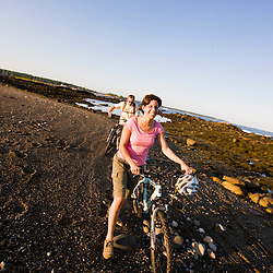 A man and woman biking at Odiorne State Park in Rye, New Hampshire.