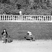 People relaxing in The Jardin du Luxembourg. The Luxembourg Gardens, is the second largest public park in Paris, located in the 6th arrondissement of Paris, France. The park is the garden of the French Senate, which is itself housed in the Luxembourg Palace.  Paris, France, 28th February 2011 .