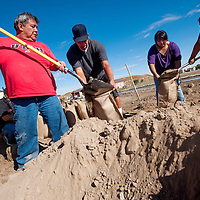 091413       Cable Hoover<br /> <br /> Student and staff volunteers Benjamin Keith, left, Mike McMillan, Bridgitte Williams and Tiffany Clark fill sand bags at Navajo Technical University in Crownpoint Saturday.