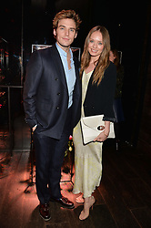SAM CLAFLIN and LAURA HADDOCK at the Lancôme pre BAFTA party held at The London Edition, 10 Berners Street, London on 14th February 2014.