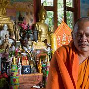 Buddhist monk in Wat Manoram temple (Luang Prabang (Louangphrabang), Laos - Nov. 2008) (Image ID: 081124-0928081a)