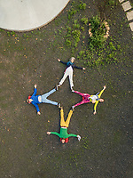 Aerial view of a family drawing a star with their bodies in Fuerteventura, Canary Islands.