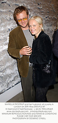 MARIELLA FROSTRUP and her husband, at a party in London on 20th May 2003.PJU 87